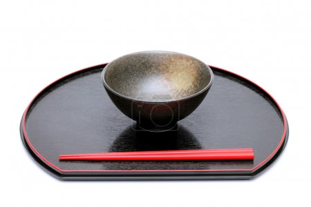Photo for Japanese rice bowl and chopsticks on wooden tray - Royalty Free Image