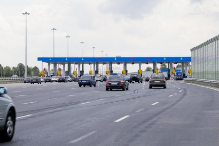 Road toll.Gate with barriers by toll road on the highway