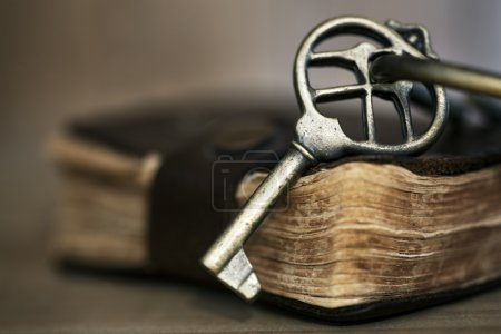 Antique Brass Key on Old Book