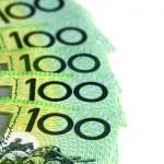 Australian one hundred dollar bills fanned over wh...