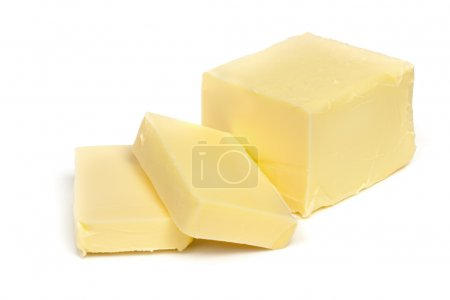 Stick of butter, cut, isolated on white....
