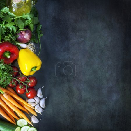 Photo for Food background with salad ingredients over dark slate. Overhead view. - Royalty Free Image