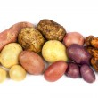 Different varieties of potatoes, isolated on white...