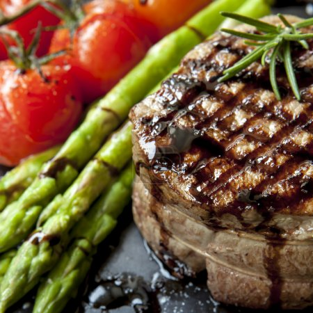Filet mignon grilled beef steak, with asparagus an...