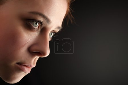 Photo for Beauty girl cry on black background - Royalty Free Image