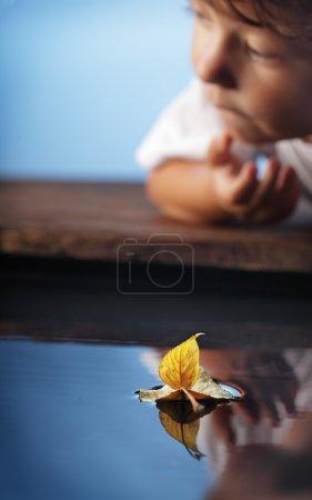 autumn leaf  ship and children  (focus on ship)