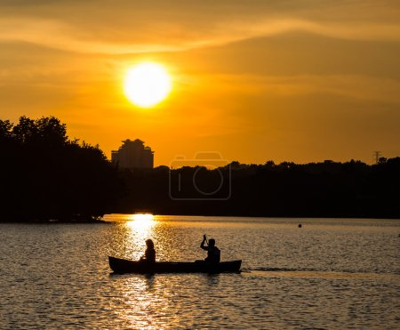 Silhoutte Couple Canoeing