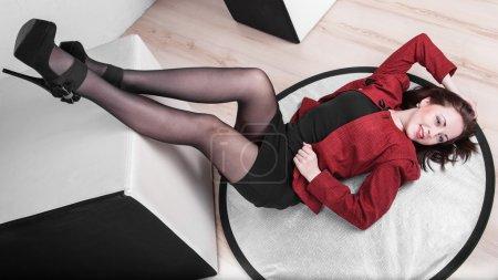 Leggy girl posing in studio