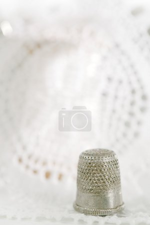 an old thimle and lace backdrop