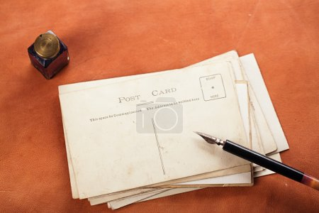 Vintage ink pen, inkpot and retro post cards