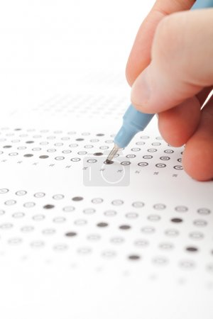 Photo for Student complete the questionnaire (filling the test form) - school exam concept and another test completing (new job interview, IQ test etc.). - Royalty Free Image