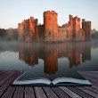 Creative concept image of medieval castle and moat...