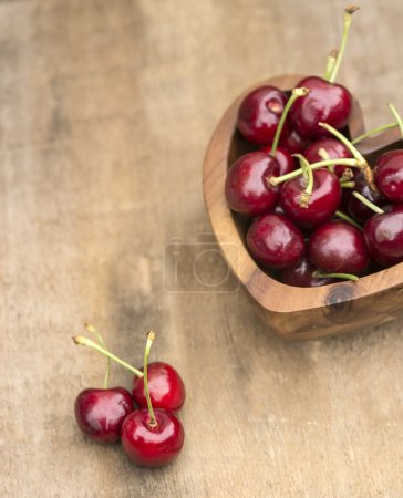 Fresh Summer cherries in wooden bowl