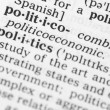 Macro image of dictionary definition of word polit...