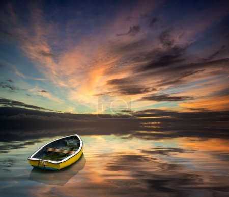 Beautiful vibrant blue and pink Winter sky with single boat floa