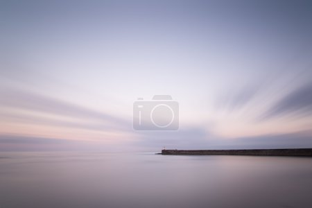 Photo for Stunning long exposure landscape lighthouse at sunset with calm sea - Royalty Free Image