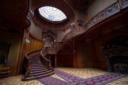 Photo for Rich entrance hall in the Lviv ancient casino with stained-glass window, twisted staircase and laced rails. - Royalty Free Image
