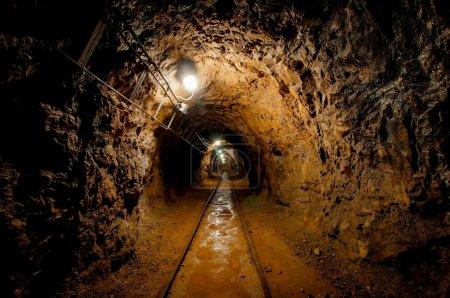 Underground mine passage with rails