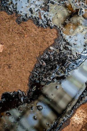 Oil contaminating the soil