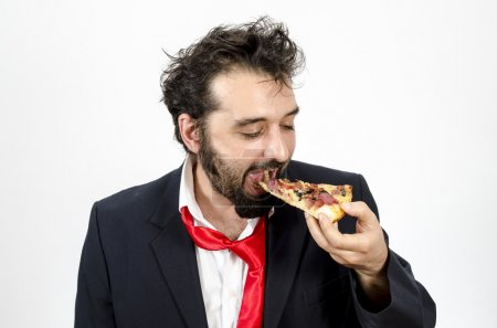 Man Biting A Slice Of Pizza