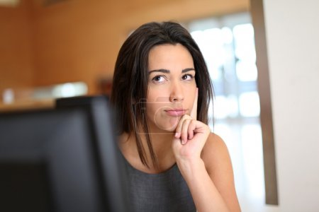 Office worker with interrogative look on her face