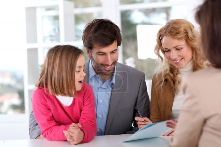 Family signing real-estate contract