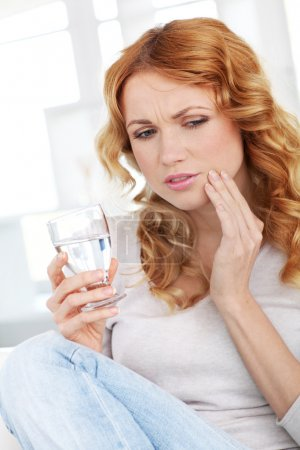 Beautiful blond woman having toothache