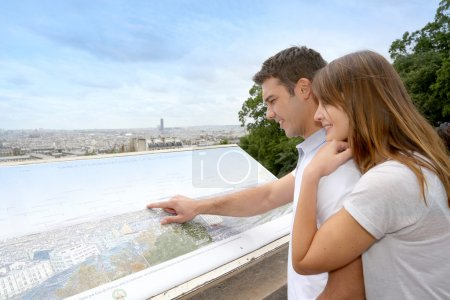 Couple in Paris looking at the city view from Montmartre