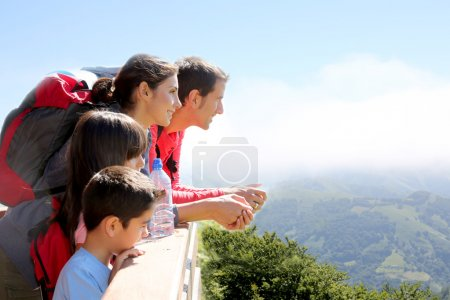 Family on a trek day in the mountain looking at the view