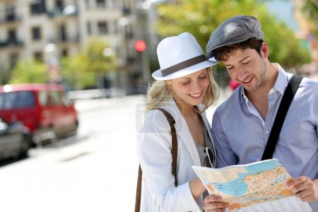Photo for Trendy young couple in town with touristic map - Royalty Free Image