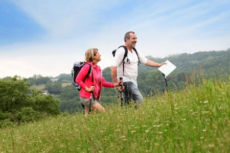 Photo for Senior couple hiking in natural landscape - Royalty Free Image