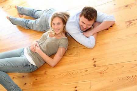 Photo for Couple at home relaxing on the floor - Royalty Free Image