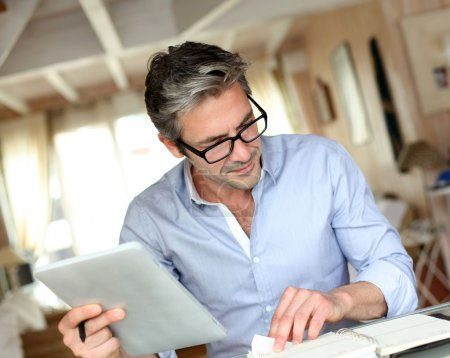 Photo for Handsome businessman with eyeglasses working from home - Royalty Free Image