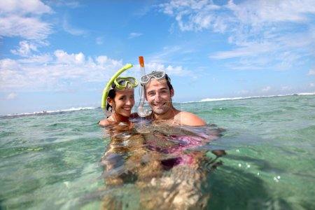 Portrait of happy couple doing snorkeling