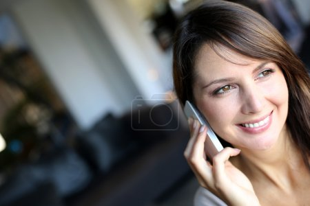 Portrait of attractive woman talking on mobile phone
