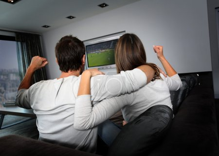 Photo for Couple having fun watching soccer game - Royalty Free Image