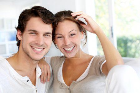 Photo for Portrait of smiling young couple at home - Royalty Free Image