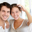 Portrait of smiling young couple at home...