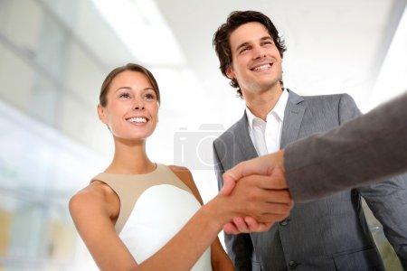 Closeup of business partnership handshake