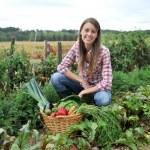 Woman knelt in vegetable garden...