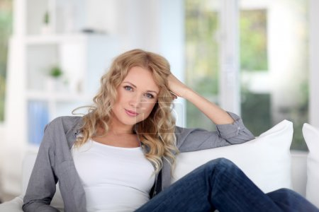 Portrait of beautiful blond woman relaxing at home
