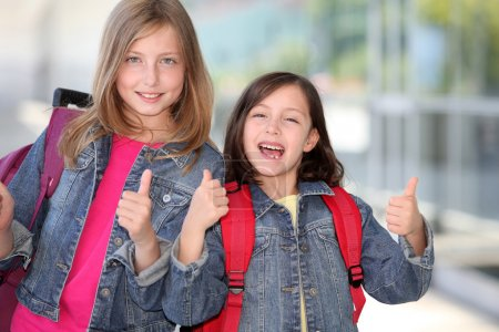 Cheerful grade-schoolers going back to school