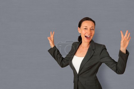 Successful businesswoman showing satisfaction