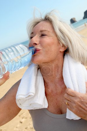 Portrait of senior woman drinking water