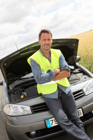 Photo for Man on the road with car breakdown waiting for rescue - Royalty Free Image