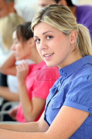Young blond woman in business training