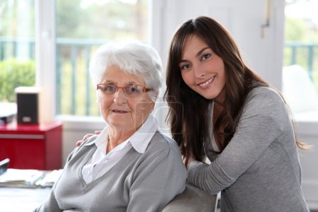 Photo for Closeup of elderly woman with young woman - Royalty Free Image