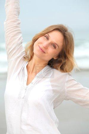 Woman breathing fresh air by the sea
