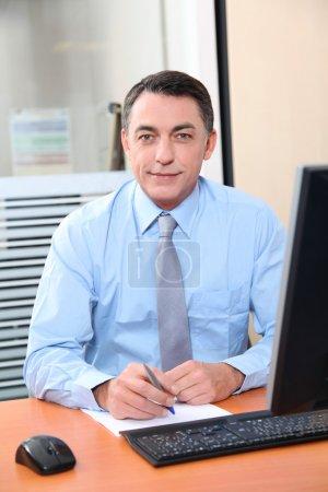 Salesman working in front of computer