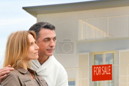 Couple in front of house for sale
